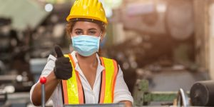 Women worker wear disposable face mask for protection Corona Virus Spreading and smoke dust air pollution filter in factory for healthy labor care.
